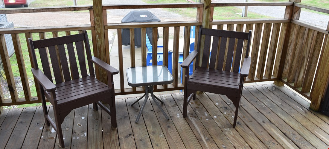 Outside seating on the deck of a studio deluxe cabin