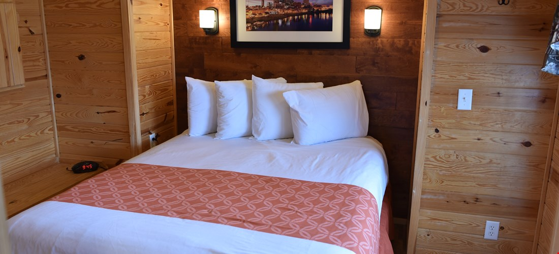 Queen bedroom in a family deluxe cabin
