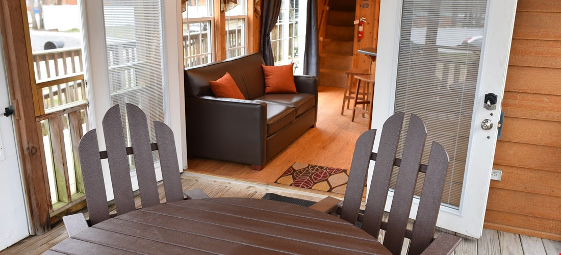 Full size table and chairs on the deck of the loft cabin