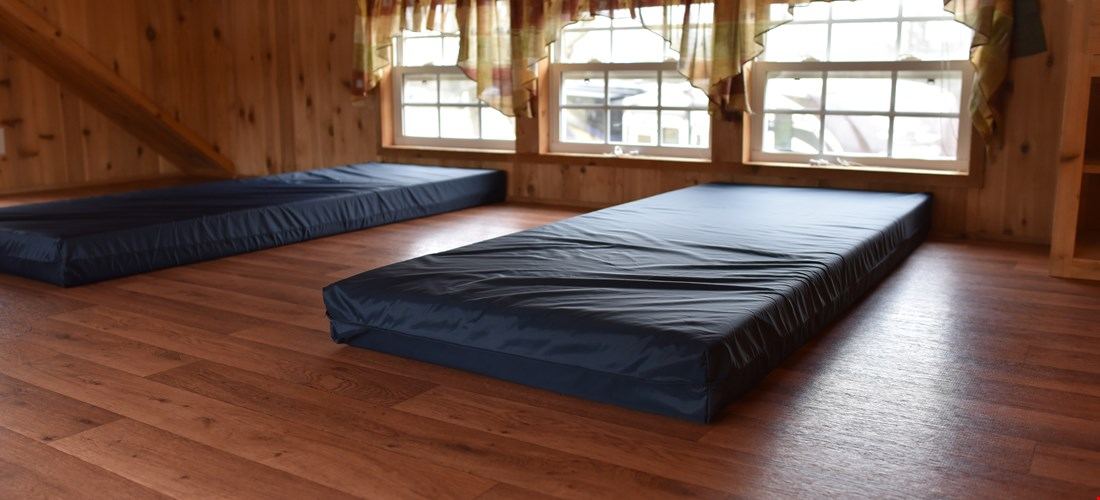 small mattresses for children in loft of deluxe cabin
