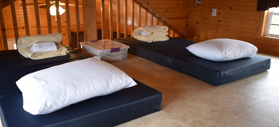 Children's mattresses in the loft of the bunk beds with loft deluxe cabin